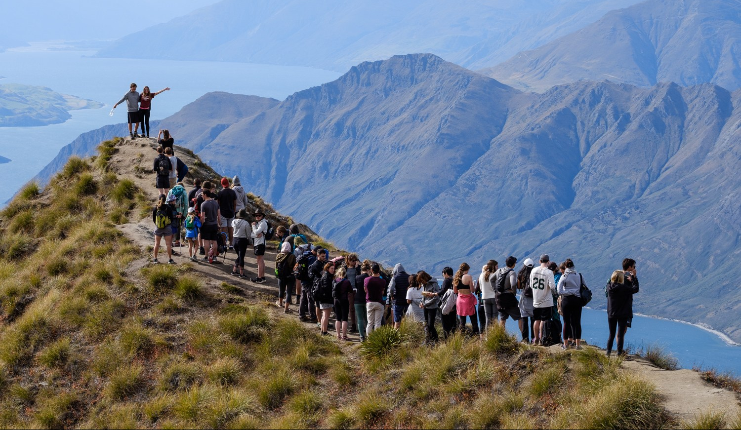 Tourists line up for selfies on Roy's Peak near Wanaka.
